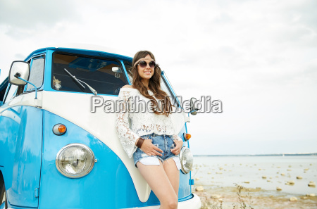 smiling young hippie woman with minivan