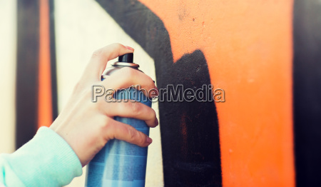 close up of hand drawing graffiti