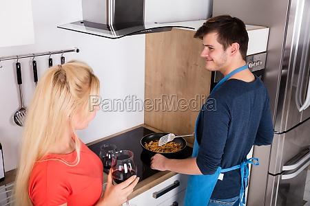 woman looking at her husband preparing