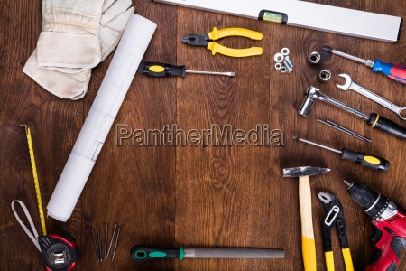 construction tools with blueprint on desk