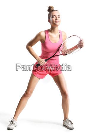 schoene sportliche frau mit squashschlaegerrschoene sportliche