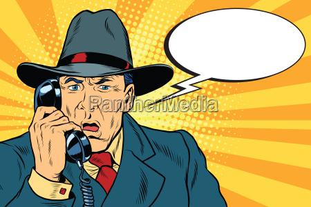 ueberrascht retro geschaeftsmann am telefon zu