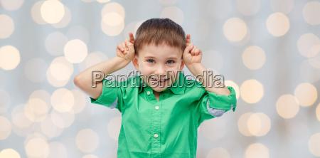 happy little boy having fun and