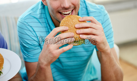 close up of happy man eating