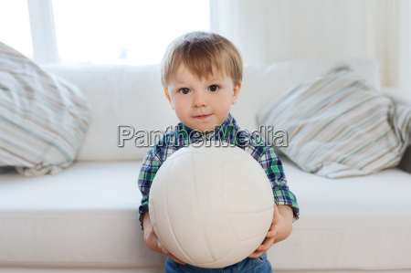 happy little baby boy with ball