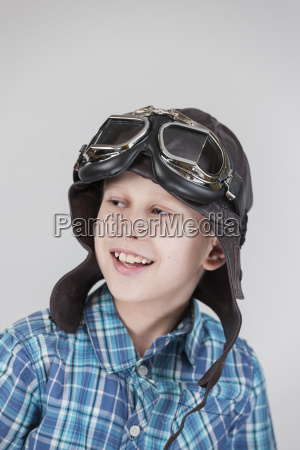 boy with leather cap looking left