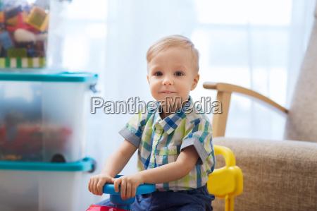 happy little baby boy driving ride