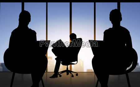 silhouette of business people working at