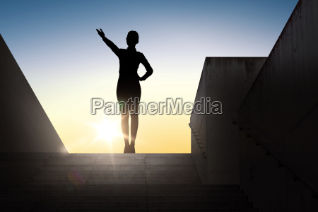 silhouette of business woman pointing hand