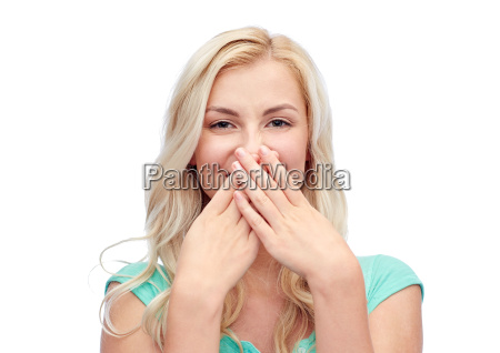 young woman or teenage girl closing