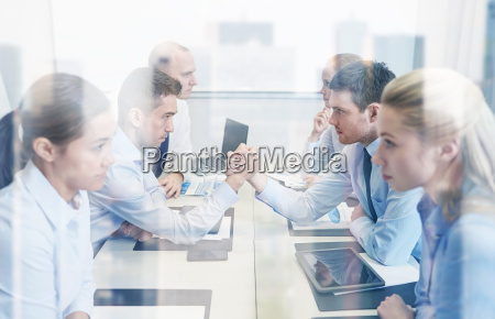 smiling business people having conflict in