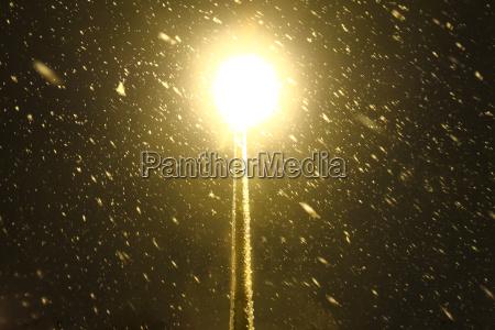 street lamp in snowfall