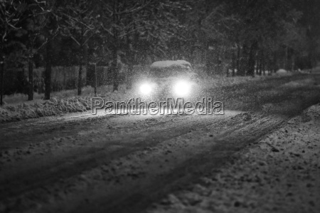 car in snowy traffic black and
