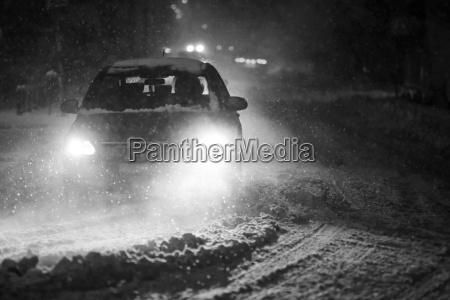 snowfall at night black and white