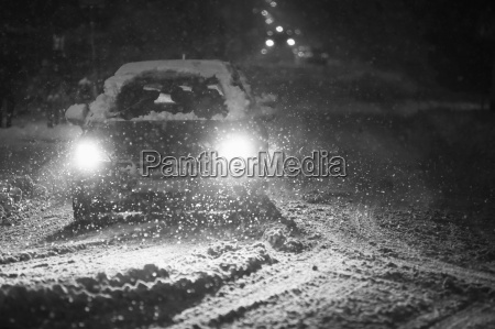snowfall on streets black and white