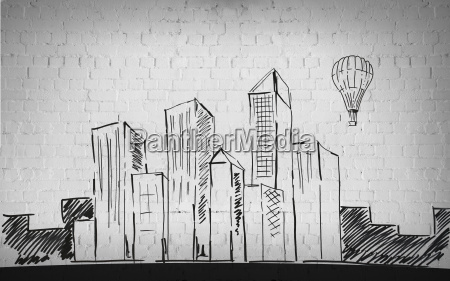 drawing of city over brick wall