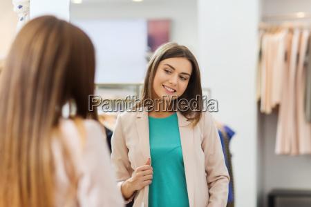 happy woman posing at mirror in