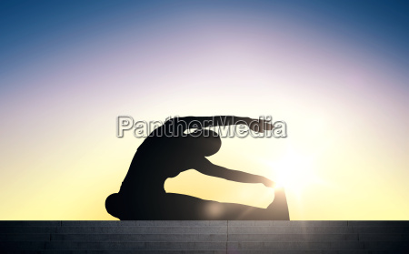 woman doing exercises on stairs over