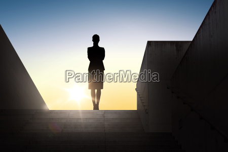 silhouette of business woman with over