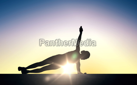 woman doing plank exercise on stairs