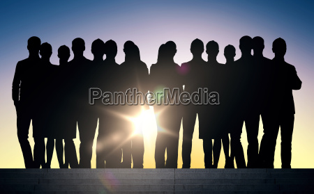 business people silhouettes on stairs over