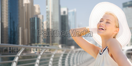happy woman enjoying summer over dubai