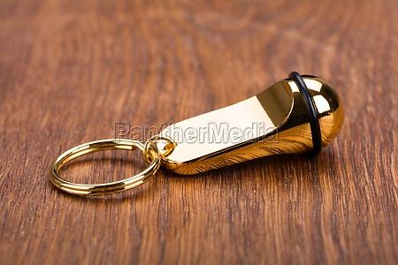 keychain on wooden desk