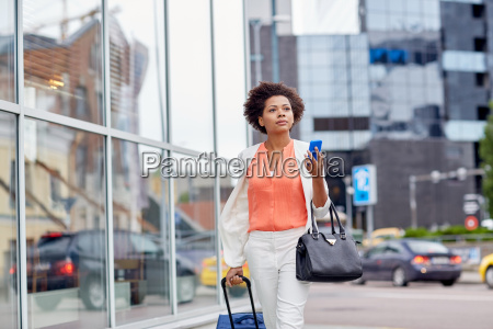 african woman with travel bag and