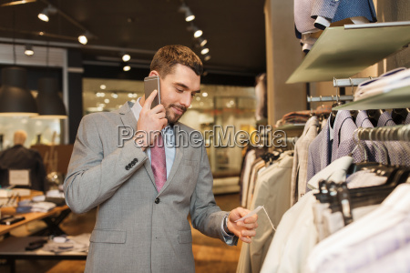 happy man calling on smartphone at
