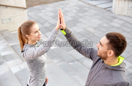 smiling couple making high five on