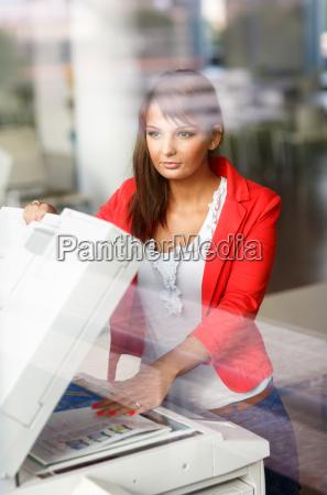 pretty young female college studentsecretary using
