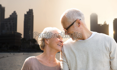 senior couple over dubai city street