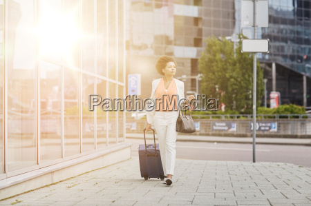 young african woman with travel bag