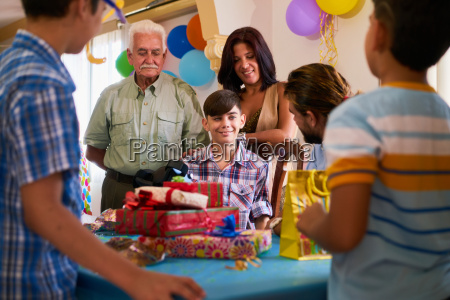 boy with family and friends celebrating