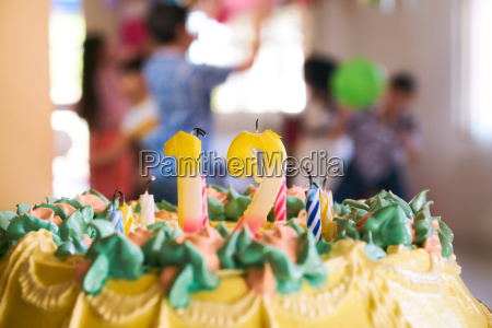 cake with 12 candles and children