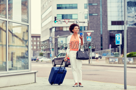 happy african woman with travel bag