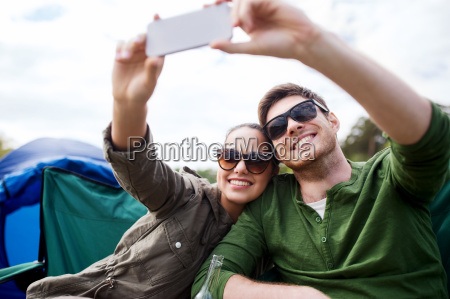 couple of travelers taking selfie by