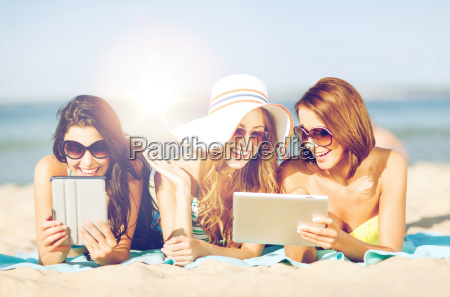 girls with tablet pc on the