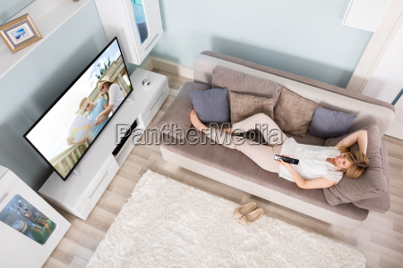 high angle view of woman watching