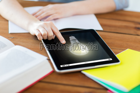 close up of student with tablet