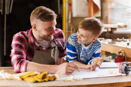 happy father and son with blueprint