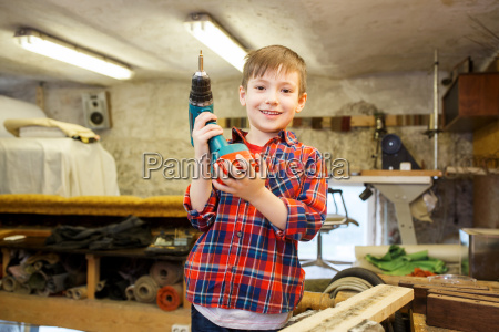 happy little boy with drill at