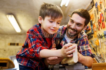 father and little son with wood