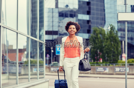 happy young african woman with travel