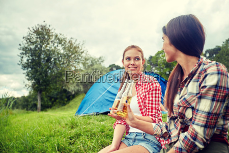 happy young women with tent and