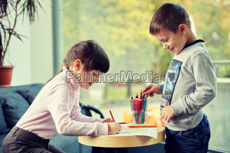 happy little girl and boy drawing