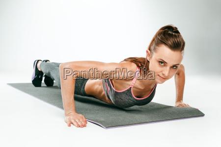 beautiful slim brunette doing some push
