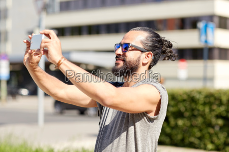 man taking video or selfie by