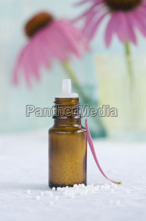 flask of globules and petal of