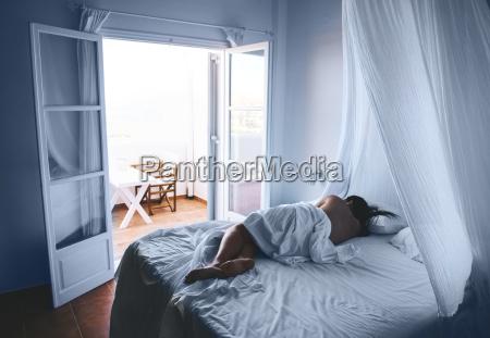 greece milos woman sleeping in white